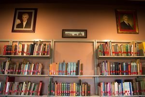 PTS library wall with books on shelves